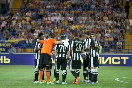 thessaloniki: KHARKIV, UKRAINE -AUG 07:Players of PAOK gathering up during the UEFA Champions League soccer match METALIST vs PAOK at Metalist Arena on August 07,2013 in Kharkiv, Ukraine. Editorial