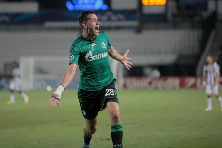 playoff: THESSALONIKI, GREECE - AUG 27 : Szalai of Schalke celebrating his goal during the Champions League play-off match PAOK vs Schalke on Aug 27, 2013 in Thessaloniki, Greece.