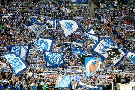 GELSENKIRCHEN, GERMANY -AUG 21: Schalke fans celebrating for their team during the match Schalke vs PAOK on Aug 21,2013 in Gelsenkirchen, Germany.