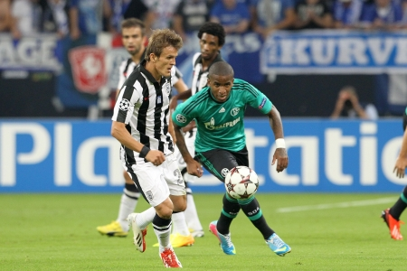 GELSENKIRCHEN, GERMANY -AUG 21: Lazar (L) of Paok in action with Farfan (R) of Schalke during the Champions League play-off match Schalke vs PAOK on Aug 21,2013 in Gelsenkirchen, Germany. Editorial