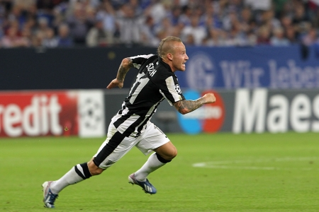 playoff: GELSENKIRCHEN, GERMANY -AUG 21: Stoch of Paok celebrating his goal during the Champions League play-off match Schalke vs PAOK on Aug 21,2013 in Gelsenkirchen, Germany.