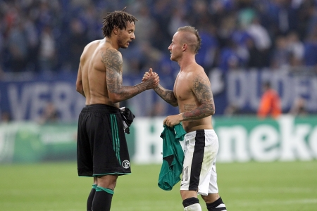 GELSENKIRCHEN, GERMANY -AUG 21: Stoch (R) of Paok exchanging his shirt with Jones (L) of Schalke after the Champions League play-off match Schalke vs PAOK on Aug 21,2013 in Gelsenkirchen, Germany.