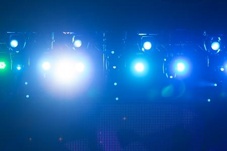 stage: Defocused entertainment concert lighting on stage, bokeh