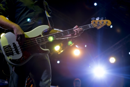 Abstract zoomed bass and performer hand on stage photo