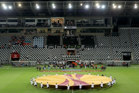 anthem: THESSALONIKI, GREECE - SEPT 19 : Rear view of the teams during the Europa League Anthem before the Europa League match PAOK vs Shakhter on September 19, 2013 in Thessaloniki, Greece.