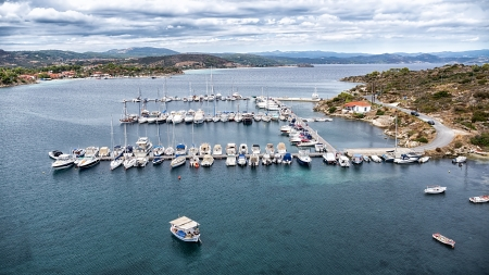 Aerial panoramic view of a marina with boats in Chalkidiki, Greece. photo