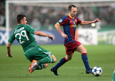 iniesta: ATHENS, GREECE - NOV 24 : Katsouranis of Panathinaikos (L) in action with Iniesta of Barcelona (R) during the UEFA Champions League group stage match Panathinaikos vs Barcelona on November 24, 2010 in Athens, Greece