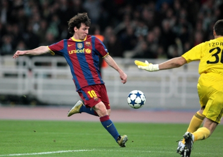 ATHENS, GREECE - NOV 24 : Messi of Barcelona shooting the ball during the UEFA Champions League group stage match Panathinaikos vs Barcelona on November 24, 2010 in Athens, Greece