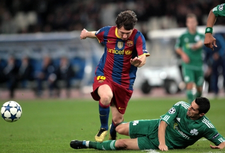 ATHENS, GREECE - NOV 24 : Spyropoulos of Panathinaikos (R) in action with Messi of Barcelona (L) during the UEFA Champions League group stage match Panathinaikos vs Barcelona on November 24, 2010 in Athens, Greece