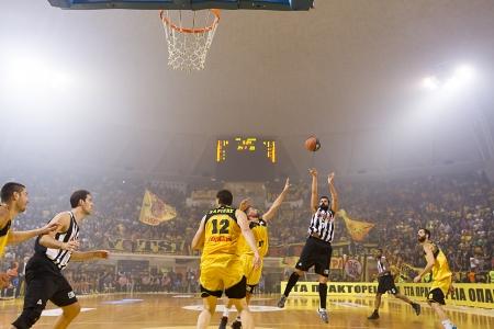 presure: THESSALONIKI, GREECE - OCT 19 : Tsohlas of Paok shoots under presure during the Greek Basket League game Aris vs Paok in Alexandreio Melathron on October 19, 2013 Thessaloniki, Greece