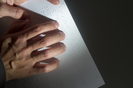 Blind reading text in braille language Stock Photo - 23963606