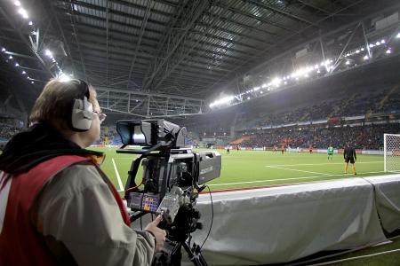 astana: ASTANA, KAZAKHSTAN NOV-28: TV media broadcasting during the europa league match Shakhter vs Paok on November 28, 2013 in Astana, Kazakhstan.