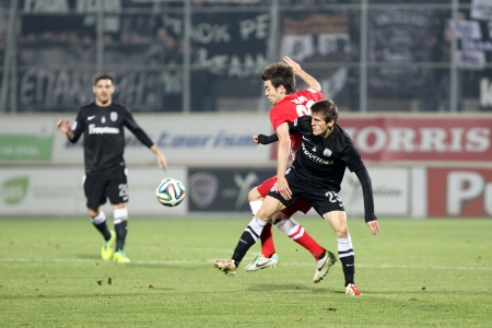 XANTHI, GREECE - JAN 5 : Lazar of Paok (R) in action with Solari of Xanthi (L) during the Greek Superleague game Skoda Xanthi vs Paok on January 5, 2014, Xanthi Greece.