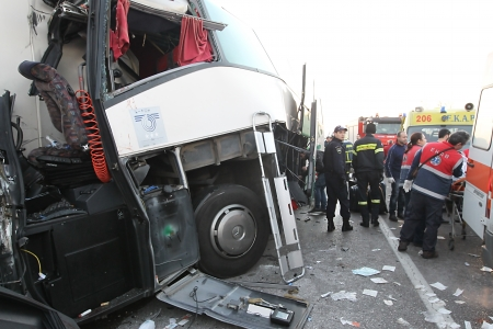 pileup: THESSALONIKI,GREECE - JAN,07: A truck hit a bus which was carrying many passengers on the Egnatia motorway in Malgara on  07January, 2014. Two women died and many others where injured