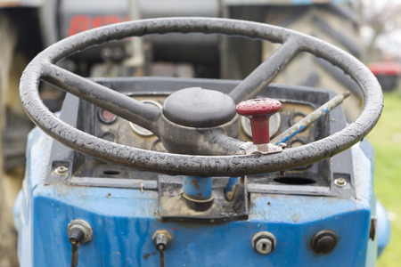A vintage tractor steering wheel photo