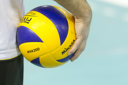 THESSALONIKI, GREECE  - FEBRUARY 15, 2014 : Closeup of hands holding a volleyball ball during the Hellenic Volleyball League game Paok vs Olympiacos at PAOK Sports Arena.