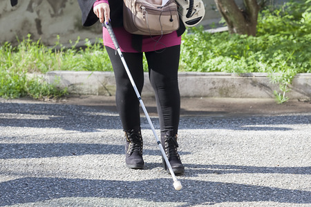 guy with walking stick: Close up in blind woman Stock Photo