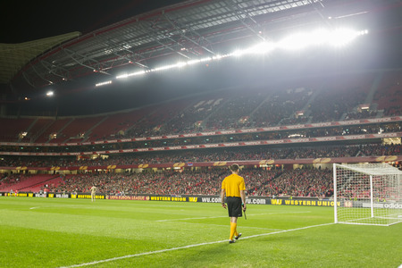 LISBON, PORTUGAL FEB - 27, 2014 : Fourth assistant referee and view of the full stadium during the UEFA Europa League game Benfica SL vs Paok on February 27, 2014.