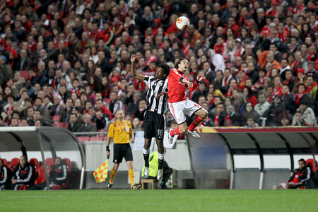 portugese: LISBON, PORTUGAL FEB - 27, 2014 : Lino of Paok (L) in action with Fejsa of Benfica (R) during the UEFA Europa League game Benfica SL vs Paok on February 27, 2014.