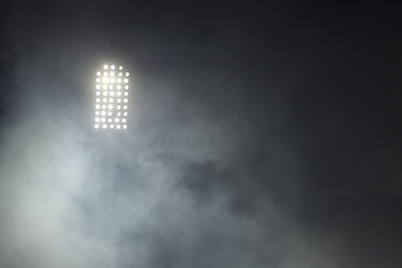 Stadium lights against dark night sky backgroundon photo
