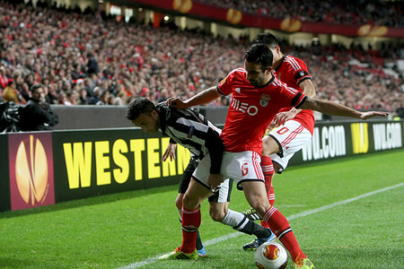 portugese: LISBON, PORTUGAL FEB - 27, 2014 : Kace of Paok (L) in action with Amorim of Benfica (R) during the UEFA Europa League game Benfica SL vs Paok on February 27, 2014. Editorial