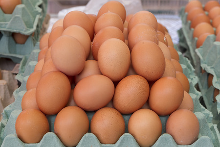 albumen: Background of fresh eggs for sale at a market Stock Photo