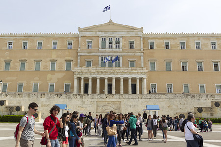 tsolias: ATHENS, GREECE - APRIL 2, 2014 : Tourists walk front the Hellenic Parliament building