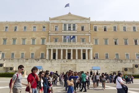 tsolias: ATHENS, GREECE - APRIL 2, 2014 : Tourists walk front the Hellenic Parliament building