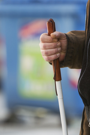 persons: Close up in blind mans hands holding a stick