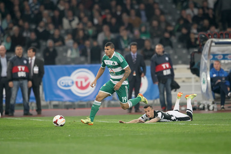ATHENS, GREECE APRIL 26, 2014 : Kace of Paok (R) in action with Karelis of Panathinaikos (L) during the Greek Cup Final match Paok vs Panathinaikos