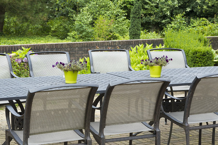 Patio furniture in a beautiful garden, close up. photo