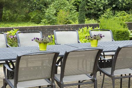 Patio furniture in a beautiful garden, close up. Stock Photo