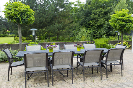 Patio furniture in a beautiful garden. photo