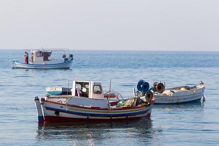 trawler net: Two small fishing boats on water