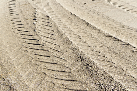 Tire tracks in sand photo