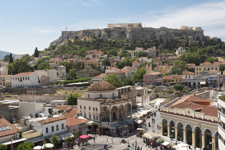 ATHENS, GREECE, MAY 15, 2013: Monastiraki square and Acropolis in Athens, Greece. Even through the metro station is closed because of the strike people are still shopping.