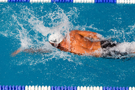 laps: THESSALONIKI, GREECE- MAY 24, 2014: Male and female participants from Balkan countries competing in Makedonian swimming race in Thessaloniki, Greece.