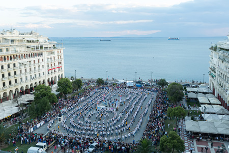 THESSALONIKI, GREECE- JUNE 1, 2014: Rueda de casino flash mob, particular type of Salsa held in Thessaloniki in order to break the Guinness World Record. 1102 people danced in Aristotelous square.