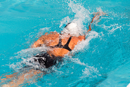 laps: female participant from Balkan countries competing in Makedonian swimming race in Thessaloniki, Greece.