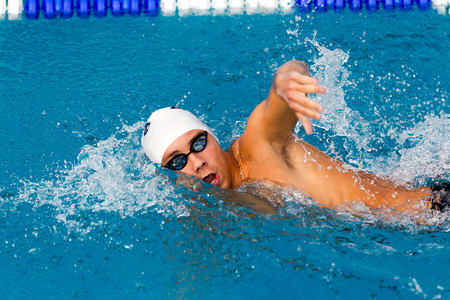 THESSALONIKI, GREECE- MAY 24, 2014: Male participant from Balkan countries competing in Makedonian swimming race in Thessaloniki, Greece.
