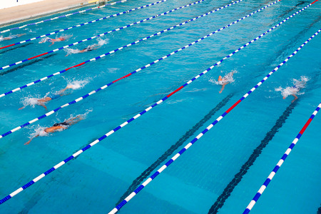 laps: Male and female participants from Balkan countries competing in Makedonian swimming race in Thessaloniki, Greece.  Stock Photo