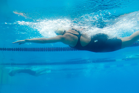 THESSALONIKI, GREECE- MAY 24, 2014: Male and female participants from Balkan countries competing in Makedonian swimming race in Thessaloniki, Greece.
