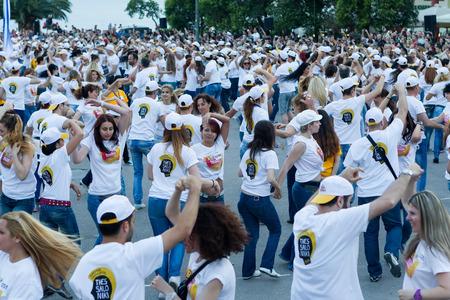 danced: THESSALONIKI, GREECE- JUNE 1, 2014: Rueda de casino flash mob, particular type of Salsa held in Thessaloniki in order to break the Guinness World Record. 1102 people danced in Aristotelous square.