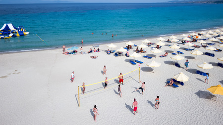HALKIDIKI, GREECE- MAY 26, 2014: People playing beach volley at the beach of Kallithea, one of the most visited destinations in Greece. Top View