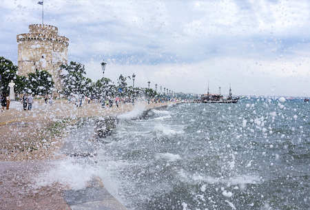 Gushing surf of a wave smashing against seaport at Thessaloniki, Greece  Stock Photo