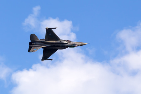 KAVALA, GREECE- JUNE 21, 2014: HAF F-16 flying in the sky during the Kavala Airshow 2014, in Kavala, Greece.
