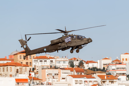 KAVALA, GREECE- JUNE 21, 2014: Apache AH-64 flying over houses during the Kavala Airshow 2014, in Kavala, Greece.