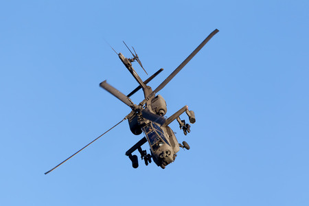 KAVALA, GREECE- JUNE 21, 2014: Apache AH-64 flying during the Kavala Airshow 2014, in Kavala, Greece.