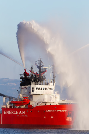 prospecting: KAVALA, GREECE- JUNE 21, 2014: Valiant energy ship throws water during the opening ceremony for the exhibition for Kavala Airshow 2014, in Kavala, Greece. Editorial