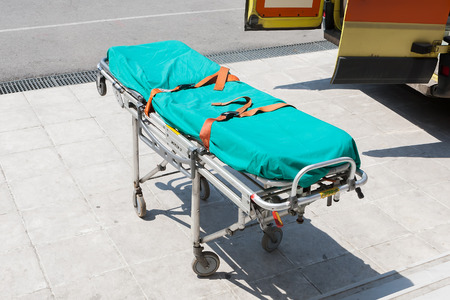 THESSALONIKI, GREECE- APRIL 24, 2013: Empty stretcher by the ambulance on the street during an earthquake exercise at 6th primary school in Thessaloniki, Greece.